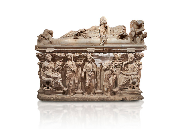 """Roman relief sculpted sarcophagus of Domitias Julianus and Domita Philiska depicted reclining on the lid, 2nd century AD, Perge. Antalya Archaeology Museum, Turkey.<br /> <br /> it is from the group of tombs classified as. """"Columned Sarcophagi of Asia Minor"""". <br /> The lid of the sarcophagus is sculpted into the form of a """"Kline"""" style Roman couch on which lie Julianus &  Philiska. This type of Sarcophagus is also known as a Sydemara Type of Tomb.. Against a white background."""