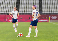 KASHIMA, JAPAN - AUGUST 2: Megan Rapinoe #15 of the USWNT stands over the ball during a game between Canada and USWNT at Kashima Soccer Stadium on August 2, 2021 in Kashima, Japan.