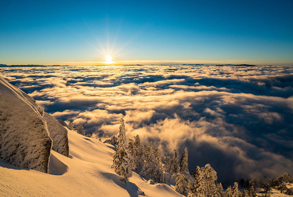 The sun sets over Lake Tahoe filled with an inversion layer.