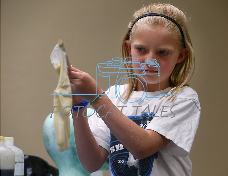 Grace Walt, 9, helps with an experiment during the Mad Science event at the Carson City Library, in Carson City, Nev., on Tuesday, July 15, 2014.<br /> Photo by Cathleen Allison