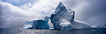 An iceberg rises of the ocean waters in Southern Ocean, Antarctica.