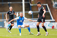 1st May 2021; Weston Homes Stadium, Peterborough, Cambridgeshire, England; English Football League One Football, Peterborough United versus Lincoln City; Dan Butler of Peterborough United watches Regan Poole of Lincoln City control a long ball