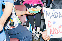 Delegates share food while sitting in the delegate area during a speech at the Democratic National Convention at the Wells Fargo Center in Philadelphia, Pennsylvania, on Wed., July 27, 2016.