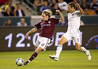 Colorado Rapids forward Tom McManus takes a shot on goal past LA's Greg Vanney. LA Galaxy defeated the Colorado Rapids 3-2 at Home Depot Center stadium in Carson, California on Sunday October 12, 2008. Photo by Michael Janosz/isiphotos.com