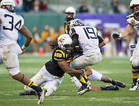SAN FRANCISCO, CA - December 29, 2012: Arizona State linebacker Grandville Taylor (56) sacks the Navy quarterback during the Navy Midshipmen vs the Arizona State Sun Devils in the 2012 Kraft Fight Hunger Bowl at AT&T Park in San Francisco, California. Final score Navy 28, Arizona State 62.