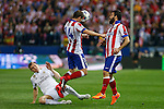 Atletico de Madrid's Gabi and Arda Turan and Real Madrid´s Toni Kroos during quarterfinal first leg Champions League soccer match at Vicente Calderon stadium in Madrid, Spain. April 14, 2015. (ALTERPHOTOS/Victor Blanco)