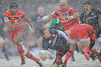 Anthony Allen of Leicester Tigers offloads as he is tackled during the Heineken Cup 6th round match between Leicester Tigers and Stade Toulousain at Welford Road on Sunday 20th January 2013 (Photo by Rob Munro).