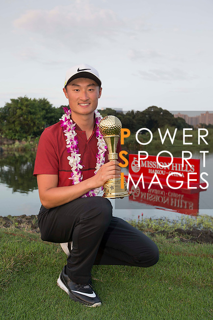Li Haotong of China poses with the trophy after winning the World Celebrity Pro-Am 2016 Mission Hills China Golf Tournament on 23 October 2016, in Haikou, Hainan province, China. Photo by Victor Fraile / Power Sport Images