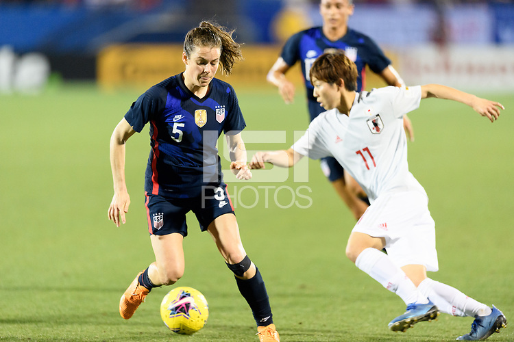 FRISCO, TX - MARCH 11: Kelley O'Hara #5 of the United States attempts to gain control of the ball during a game between Japan and USWNT at Toyota Stadium on March 11, 2020 in Frisco, Texas.