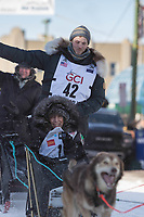 Niklas Wikstrand and team leave the ceremonial start line with an Iditarider at 4th Avenue and D street in downtown Anchorage, Alaska on Saturday March 2nd during the 2019 Iditarod race. Photo by Brendan Smith/SchultzPhoto.com