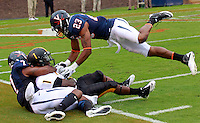 Virginia Cavaliers safety Corey Mosley (7) and Virginia Cavaliers cornerback Dom Joseph (23) defend Southern Miss Golden Eagles wide receiver Tracy Lampley (1)during the game at Scott Stadium. Virginia was defeated 30-24. (Photo/Andrew Shurtleff)