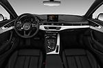 Stock photo of straight dashboard view of a 2018 Audi A4 Premium 4 Door Sedan