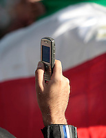 A man use a mobile phone to photograph during a demonstration in Oslo, Norway, following the election in Iran. A protest arranged by Amnesty International Norway was held in front of the Norwegian Parliament, before Iranian diaspora and others marched to the Iranian embassy to continue their protest. .©Fredrik Naumann/Felix Features.