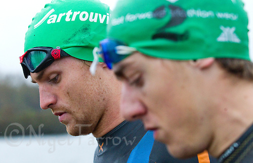 28 APR 2012 - LES SABLES D'OLONNE, FRA - EC Sartrouville's David Macnamee (left) and Fernando Alarza (right) wait for the start of the prologue round of the French Grand Prix Series triathlon in Les Sables d'Olonne, France (PHOTO (C) 2012 NIGEL FARROW)