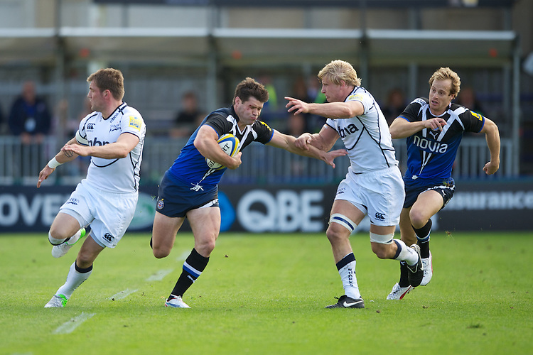Dan Hipkiss of Bath Rugby is tackled by David Seymour of Sale Sharks during the Aviva Premiership match between Bath Rugby and Sale Sharks at the Recreation Ground on Saturday 29th September 2012 (Photo by Rob Munro)