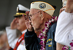An unidentified Pearl Harbor survivor salutes during the National Anthem during the 71st Anniversary Pearl Harbor Day Commemoration at the Pearl Harbor Visitor Center in Honolulu, HI on, Dec. 7, 2012. .Photo by Cathleen Allison