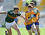 Shane Meehan of Clare in action against Owen Fitgerald of Kerry during their Munster Minor football final at Pairc Ui Chaoimh. Photograph by John Kelly.