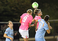 Allie Long #9 and Sonia Bompastor #8 of the Washington Freedom head the ball away from Yael Averbuch #13 of Sky Blue FC during a WPS match at Maryland Soccerplex on August 28 2010, in Boyds, Maryland. Freedom won 2-1.