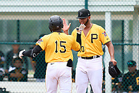 FCL Pirates Gold Rodolfo Nolasco (15) high fives Listher Sosa (70) after hitting a home run during a game against the FCL Pirates Gold on July 2, 2021 at Pirate City in Bradenton, Florida.  (Mike Janes/Four Seam Images)