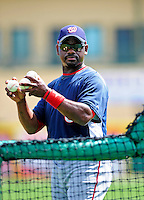 16 March 2009: Washington Nationals' first base coach and former Major Leaguer Marquis Grissom tosses a round of batting practice prior to a Spring Training game against the Florida Marlins at Roger Dean Stadium in Jupiter, Florida. The Nationals defeated the Marlins 3-1 in the Grapefruit League matchup. Mandatory Photo Credit: Ed Wolfstein Photo