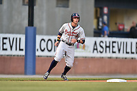 Rome Braves right fielder Braxton Davidson (24) leads off third during a game against the Asheville Tourists on May 15, 2015 in Asheville, North Carolina. The Braves defeated the Tourists 6-0. (Tony Farlow/Four Seam Images)