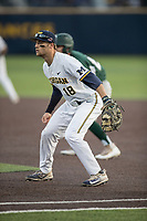 Michigan Wolverines first baseman Jake Bivens (18) on defense against the Michigan State Spartans during the NCAA baseball game on April 18, 2017 at Ray Fisher Stadium in Ann Arbor, Michigan. Michigan defeated Michigan State 12-4. (Andrew Woolley/Four Seam Images)