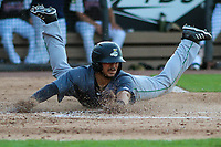 Clinton LumberKings third baseman Eugene Helder (5) slides into home plate during a Midwest League game against the Wisconsin Timber Rattlers on June 29, 2018 at Fox Cities Stadium in Appleton, Wisconsin. Clinton defeated Wisconsin 9-7. (Brad Krause/Four Seam Images)