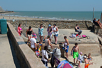 FOLKESTONE, KENT, England - 30.05.2020<br /> .<br /> People enjoy the summer weekend sun but not social distancing at Folkestone Harbour, as the government lockdown is due to be relaxed further on Monday including allowing groups of 6 to meet up as the COVID-19 pandemic continues in High Wycombe, Bucks on 30 May 2020. Photo by Alan Stanford.