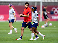 KASHIMA, JAPAN - AUGUST 2: Milan Ivanovic talks to Crystal Dunn #2 of the USWNT before a game between Canada and USWNT at Kashima Soccer Stadium on August 2, 2021 in Kashima, Japan.