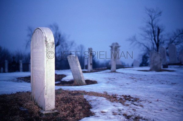 Original Image Photographed on Kodachrome Color Transparency Film in February 1982.<br /> <br /> Cemetery at Dusk in the Winter, New Brunswick, New Jersey, USA