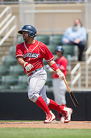 Wilson Garcia (25) of the Lakewood BlueClaws follows through on his swing against the Kannapolis Intimidators at Kannapolis Intimidators Stadium on May 8, 2016 in Kannapolis, North Carolina.  The Intimidators defeated the BlueClaws 3-2.  (Brian Westerholt/Four Seam Images)
