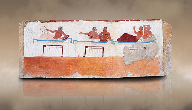 """Greek Fresco on the inside of Tomb of  the Diver  [La Tomba del Truffatore] from the Greek city of Poseidonia which became Roman Paestum. This panel is from one of the long sides of the tomb and shows a symposium of men lying on couches facing low tables.  The men on the couches are playing the song of Eros the liar and the flute to distract the deceased from worldly thoughts so he can enter the next world. The tomb is painted with the true fresco technique and its importance lies in being """"the only example of Greek painting with figured scenes dating from the Orientalizing, Archaic, or Classical periods to survive in its entirety. Paestrum, Andriuolo.  (480-470 BC  )"""