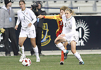 Lindsay Tarpley #5 of the USA WNT battles with Fan Yu #3 of the PRC WNT during an international friendly match at PPL Park, on October 6 2010 in Chester, PA. The game ended in a 1-1 tie.