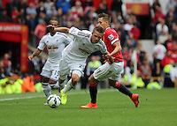 Pictured L-R: Gylfi Sigurdsson of Swansea against Adnan Januzaj of Manchester United. Saturday 16 August 2014<br />