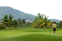 Marina Ixtapa Golf Course is one of two 18-hole public golf courses in  Zihuatanejo/Ixtapa. Many locals and visitors (especially the Canadian and American tourists it attracts) consider this the best -- and most challenging. The course has 86 sand traps and water features that are home to crocodiles. Green fees are $80 US per person during high season and $55 US per person in low season (not including cart).  (taken August 2007). Unknown, not identifiable person in photo. Photo by Patrick Schneider Photo.com