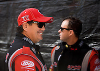 Nov 10, 2013; Pomona, CA, USA; NHRA top fuel dragster driver Billy Torrence (left) with son Steve Torrence during the Auto Club Finals at Auto Club Raceway at Pomona. Mandatory Credit: Mark J. Rebilas-