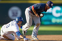 Oklahoma City RedHawks shortstop Raoul Torrez (36) blocks the throw from the outfield as Round Rock Express catcher Eli Whiteside (18) slides into second base during the Pacific Coast League baseball game on August 25, 2013 at the Dell Diamond in Round Rock, Texas. Round Rock defeated Oklahoma City 9-2. (Andrew Woolley/Four Seam Images)
