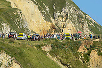BNPS.co.uk (01202 558833)<br /> Pic: Graham Hunt/BNPS<br /> <br /> The coastguard helicopter lands on the beach at Durdle Door in Dorset to deal with a medical emergency on an afternoon of scorching hot sunshine and clear blue skies.<br /> <br /> Coastguard vehicles on the cliff top above the beach.