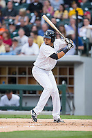 Juan Diaz (17) of the Charlotte Knights at bat against the Chicago White Sox at BB&T Ballpark on April 3, 2015 in Charlotte, North Carolina.  The Knights defeated the White Sox 10-2.  (Brian Westerholt/Four Seam Images)