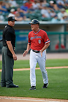 Rochester Red Wings manager Mike Quade (8) argues a call with umpire Shane Livensparger during a game against the Columbus Clippers on August 9, 2017 at Frontier Field in Rochester, New York.  Rochester defeated Columbus 12-3.  (Mike Janes/Four Seam Images)