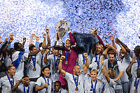 Sporting Kansas City captain Jimmy Nielsen holds the trophy aloft after the game at Livestrong Sporting Park in Kansas City, Kansas.   Sporting Kansas City won the Lamar Hunt U.S. Open Cup on penalty kicks after tying the Seattle Sounders in overtime.