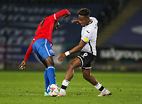 20th April 2021; Liberty Stadium, Swansea, Glamorgan, Wales; English Football League Championship Football, Swansea City versus Queens Park Rangers; Albert Adomah of Queens Park Rangers and Jamal Lowe of Swansea City challenge for the ball