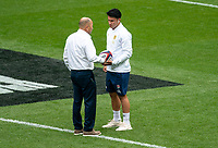 Marcus Smith (Harlequins) of England speaks to Eddie Jones head coach of England ahead of the Autumn International match between England and Canada at Twickenham Stadium, London, England on 10 July 2021. Photo by Liam McAvoy.