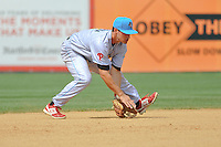 Shortstop KC Serna (5) of the Reading Fightin Phils makes a play during a game against the New Britain Rock Cats at New Britain Stadium on July 13, 2014 in New Britain, Connecticut.  Reading defeated New Britain 6-4.  (Gregory Vasil/Four Seam Images)