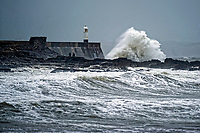 Pictured: Waves caused by strong winds batter the promenade wall and the lighthouse in Porthcawl, south Wales, UK. Wednesday 19 September 2018