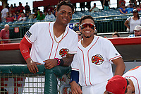 Florida Fire Frogs Cristian Pache (left) and Johan Camargo (right) in the dugout during a rain delay before a game against the Daytona Tortugas on April 7, 2018 at Osceola County Stadium in Kissimmee, Florida.  Daytona defeated Florida 4-3 in a six inning rain shortened game.  (Mike Janes/Four Seam Images)