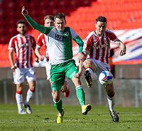 5th April 2021; Bet365 Stadium, Stoke, Staffordshire, England; English Football League Championship Football, Stoke City versus Millwall; James Chester of Stoke City under pressure from Jed Wallace of Millwall