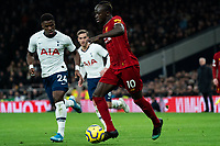 Liverpool's Sadio Mane holds off the challenge from Tottenham's Serge Aurier <br /> <br /> Photographer Stephanie Meek/CameraSport<br /> <br /> The Premier League - Tottenham Hotspur v Liverpool - Saturday 11th January 2020 - Tottenham Hotspur Stadium - London<br /> <br /> World Copyright © 2020 CameraSport. All rights reserved. 43 Linden Ave. Countesthorpe. Leicester. England. LE8 5PG - Tel: +44 (0) 116 277 4147 - admin@camerasport.com - www.camerasport.com