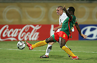 The United States' Brian Ownby (15) loses the ball to Cameroon's Enow Tabot (5) during the FIFA Under 20 World Cup Group C Match between the United States and Cameroon at the Mubarak Stadium on September 29, 2009 in Suez, Egypt.
