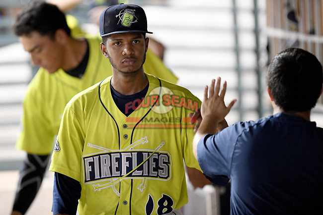 Starting pitcher Daison Acosta (18) of the Columbia Fireflies is greeted after coming out of a game against the Hickory Crawdads on Wednesday, August 28, 2019, at Segra Park in Columbia, South Carolina. Hickory won, 7-0. (Tom Priddy/Four Seam Images)